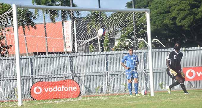 Solomon Islands goal keeper Isomo Bird watches as Vodafone Fiji Kolinio Sivoki shot beats him at the Churchill Park in Lautoka yesterday. Photo: WAISEA NASOKIA