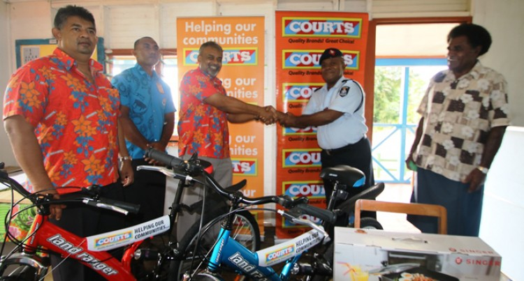 Courts Gives Helping Hand to Community Post
