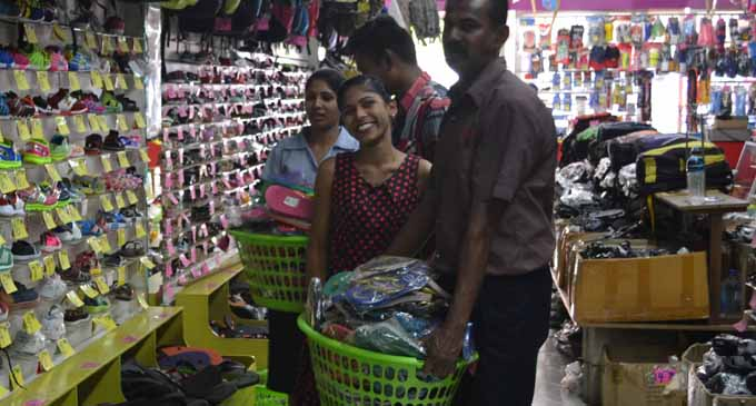Hiralal and Sons Limited staff moving shoes to higher shelves on May 11 2017 .PHOTO: PENI DRAUNA