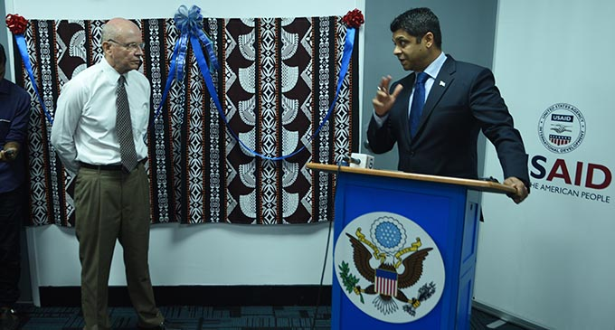 The Attorney General Aiyaz Sayed-Khaiyum thanbks Les Baker of the USAids Climate Ready office in Suva before unveiling the plaque yesterday. Photo:Jone Luvenitoga