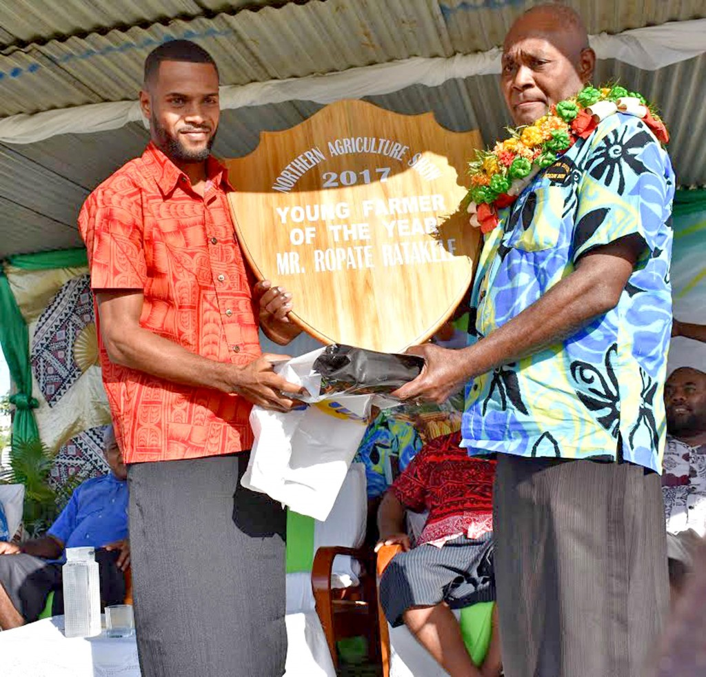 Young Farmer of the year Ropate Ratakele receiving his award from chief guest Divisional Planning Officer Alipate Bolalevu. Photo: Josaia Ralago