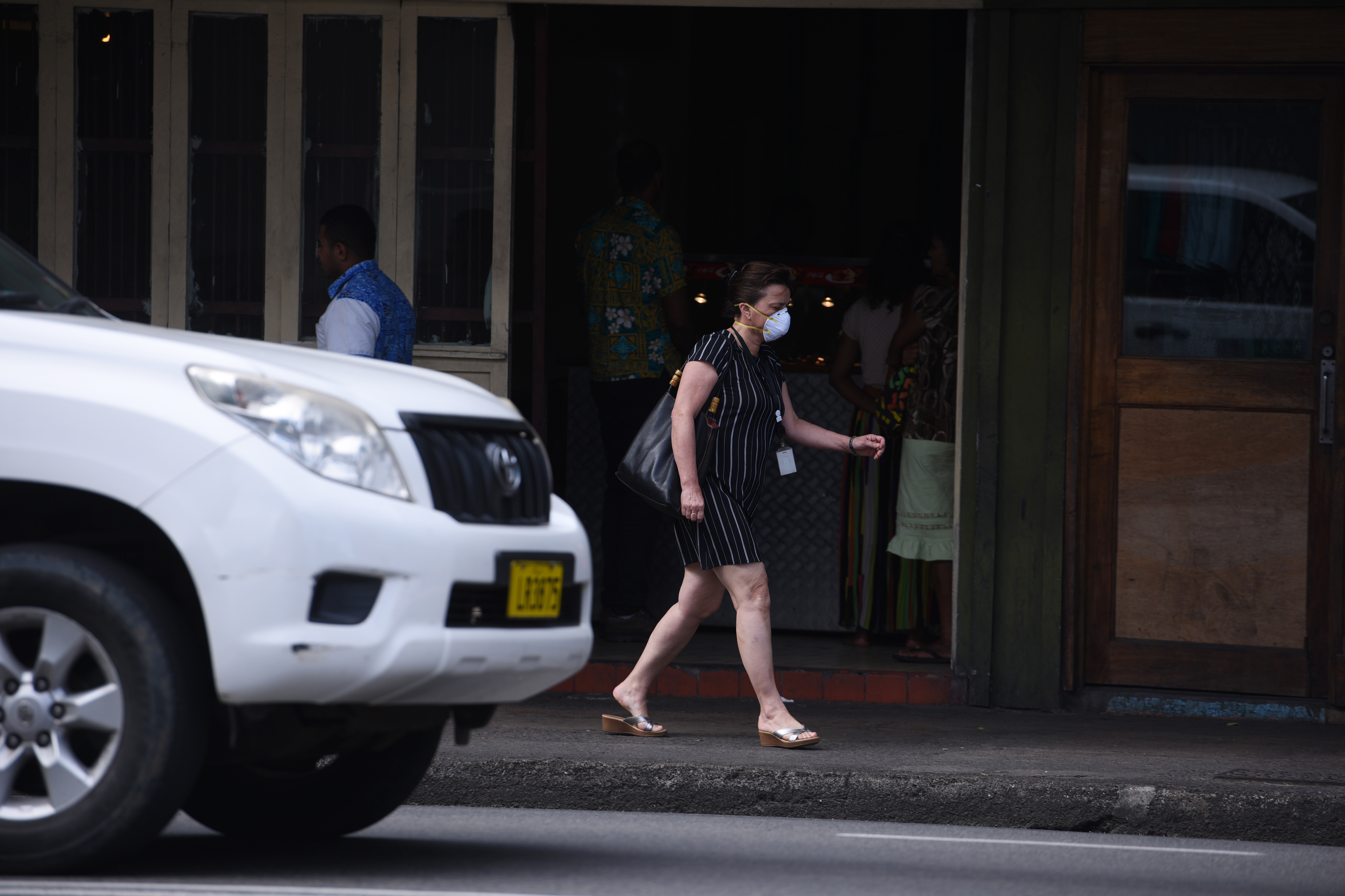 A woman walks with her mask on along Voctoria Parade due to the asbestos scare in Suva on Friday June 2nd, 2017. Photo:Jone Luvenitoga