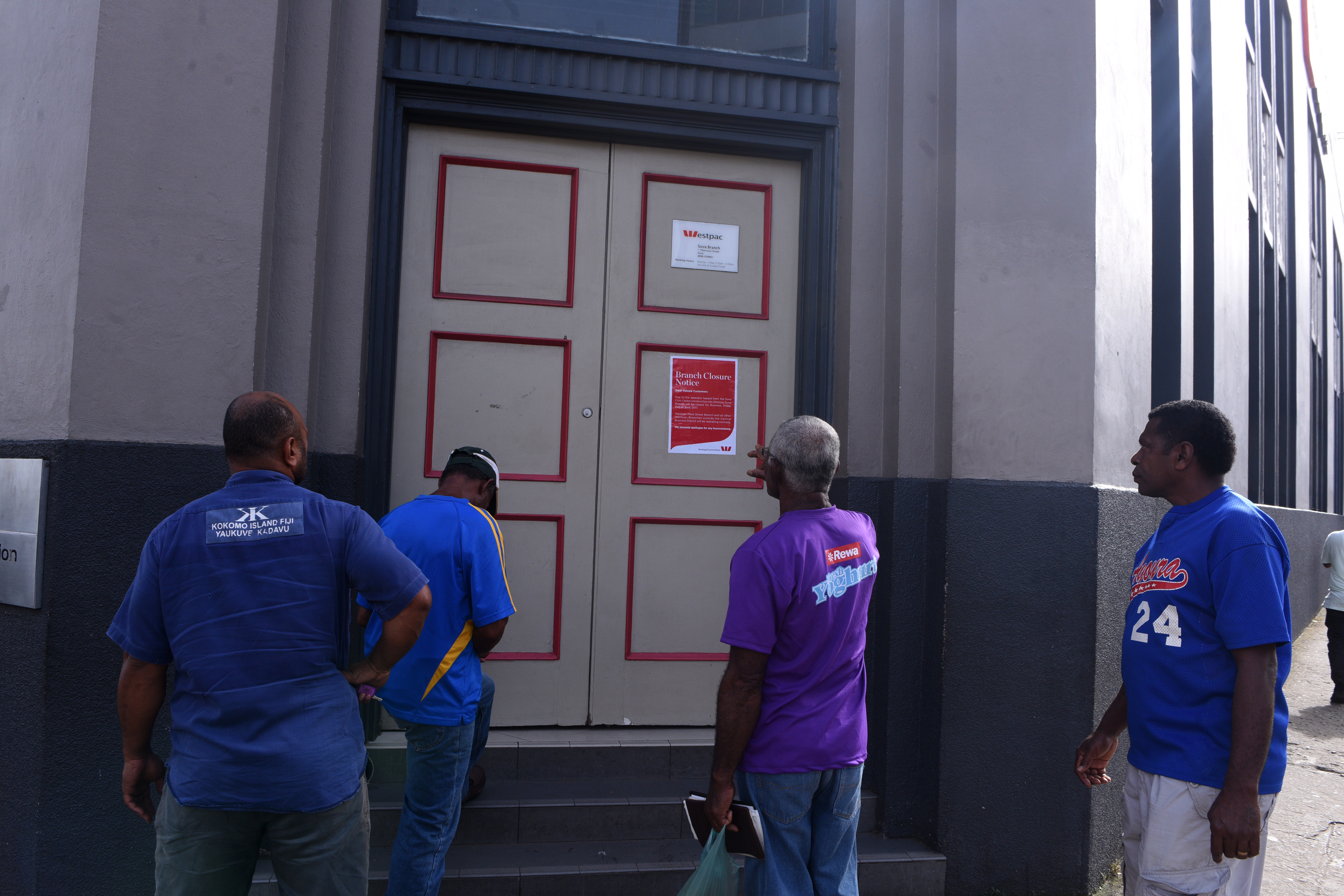 People standing outside the Westpac Bank, thatw as closed for business due to asbestos threat in Suva. Photo:Jone Luvenitoga