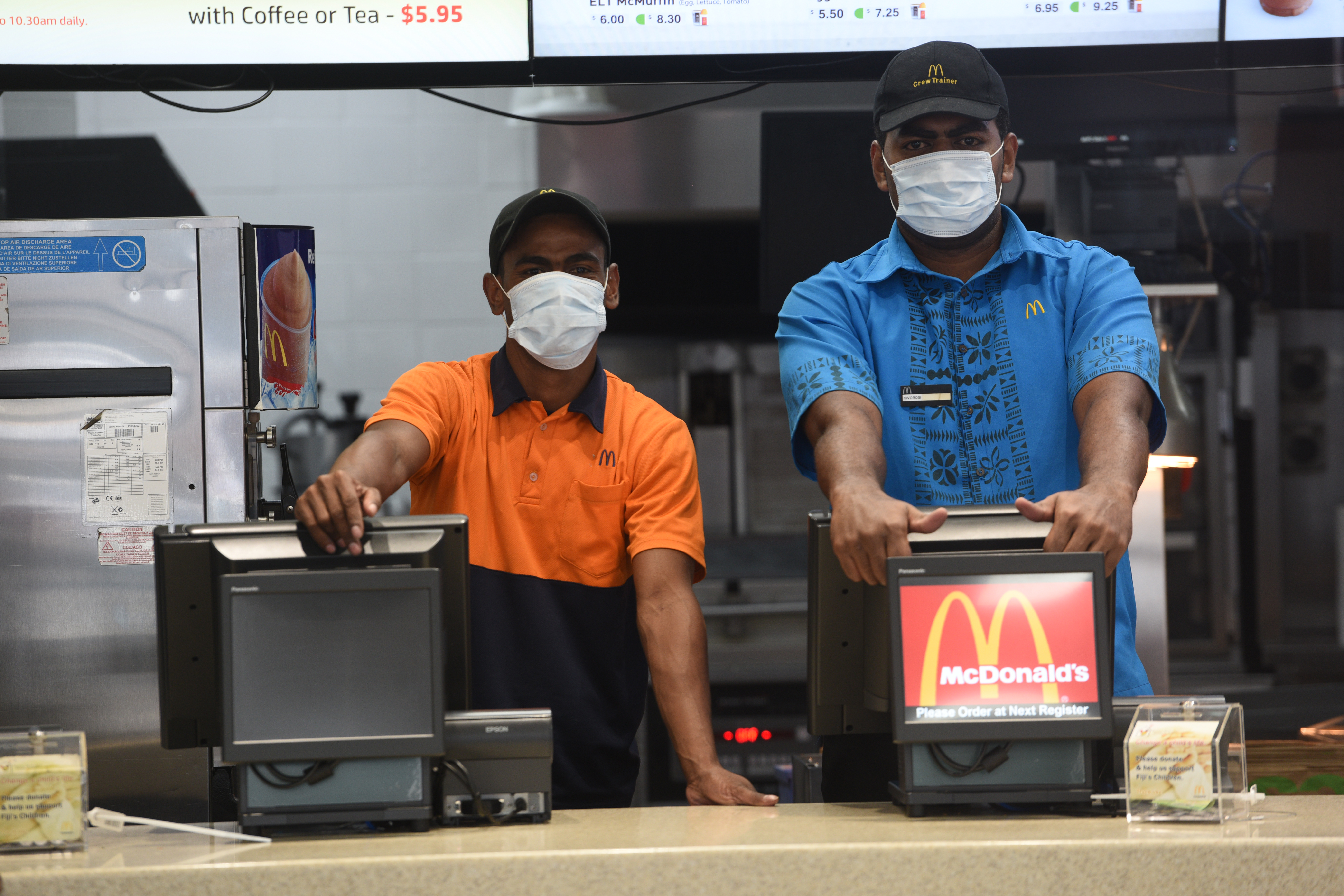 Sales assistants at MacDonald wearing safety breathing masks in the morning before they closed due mto asbestos threats. Photo:Jone Luvenitoga