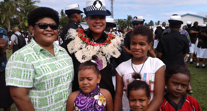 A proud Torika Ucuucu Raguru with family members after the Fiji Police Force passing-out parade at Nasova, Suva, on June 28, 2017. Photo: Mere Satakala
