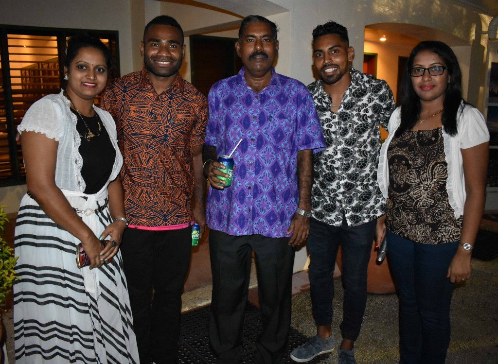 Jerry Tuwai (second from the left) Roy Krishna (second from the right) with staff of Labasa Discount Flight Centre during the Fiji Link third birthday cocktail function at Grand Eastern Hotel in Labasa last night. Photo:SHRATIKA NAIDU