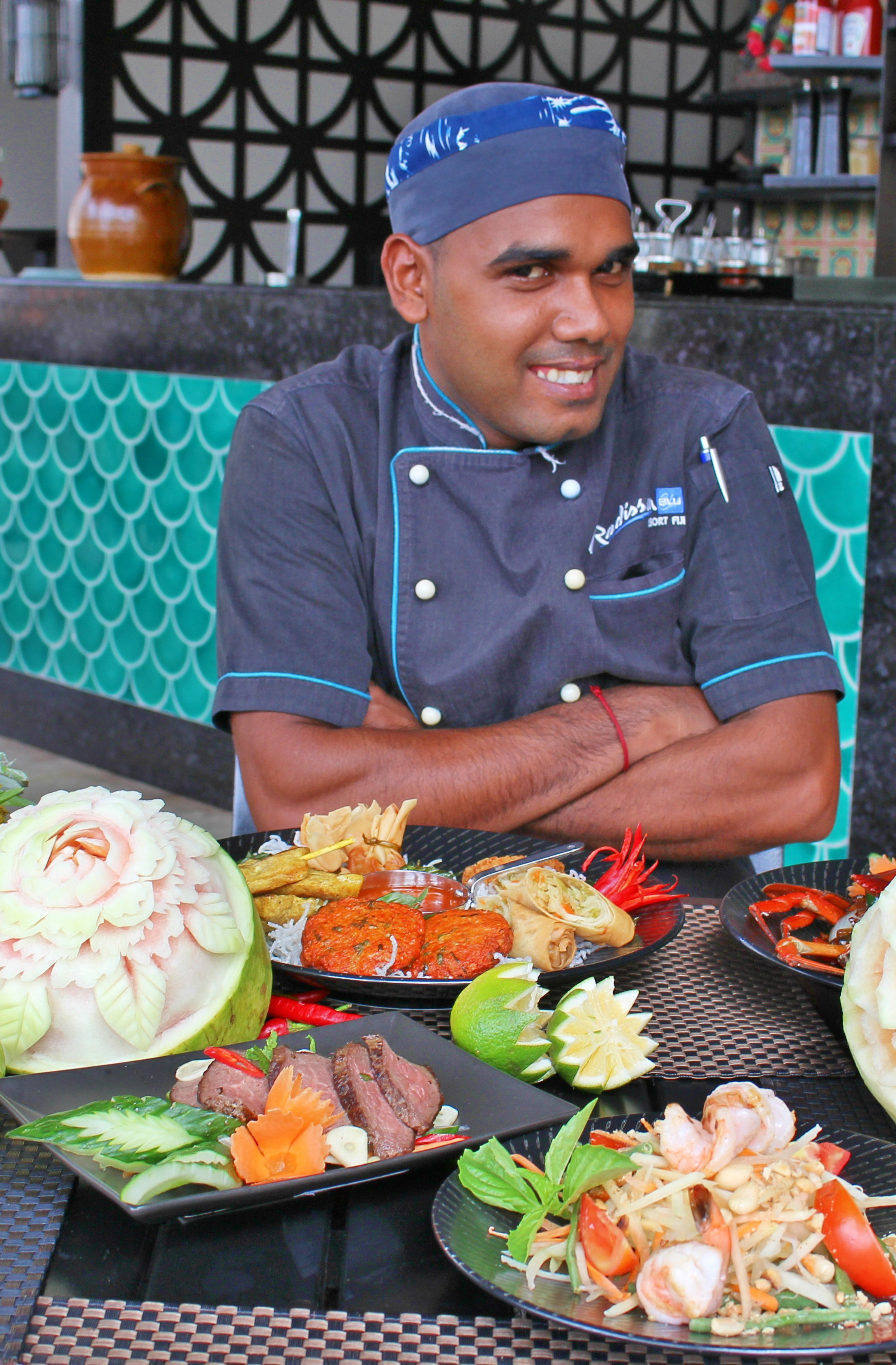 Chef Shelvin with his signature Thai Grilled Beef Salad and other meals. Photo: MARIKA SERU/RADISSON BLU