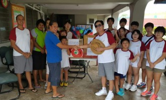 Korean students lend a hand at St Mina's