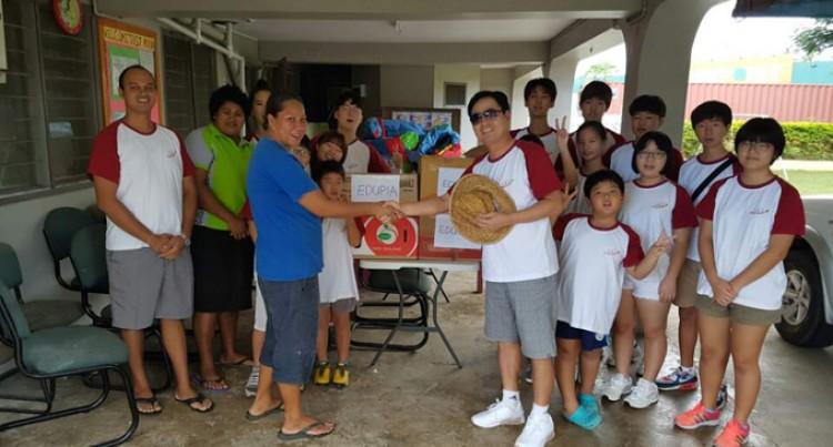 Korean students lend a hand at St Mina's