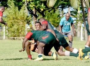 Army tacklers take down a Pacific Energy Kinoya Sea Eagles team. Photo:Jone Luvenitoga
