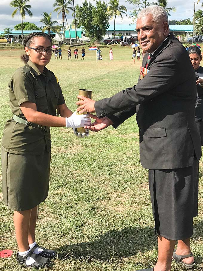 Parade Commander Jelenda Judith Vosalevu receives the Baton of Honour from chief guest Jeremaia Waqanisau.  Photo: Charles Chambers