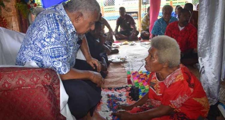 Mother, 64, Braves Rain To Meet Hero