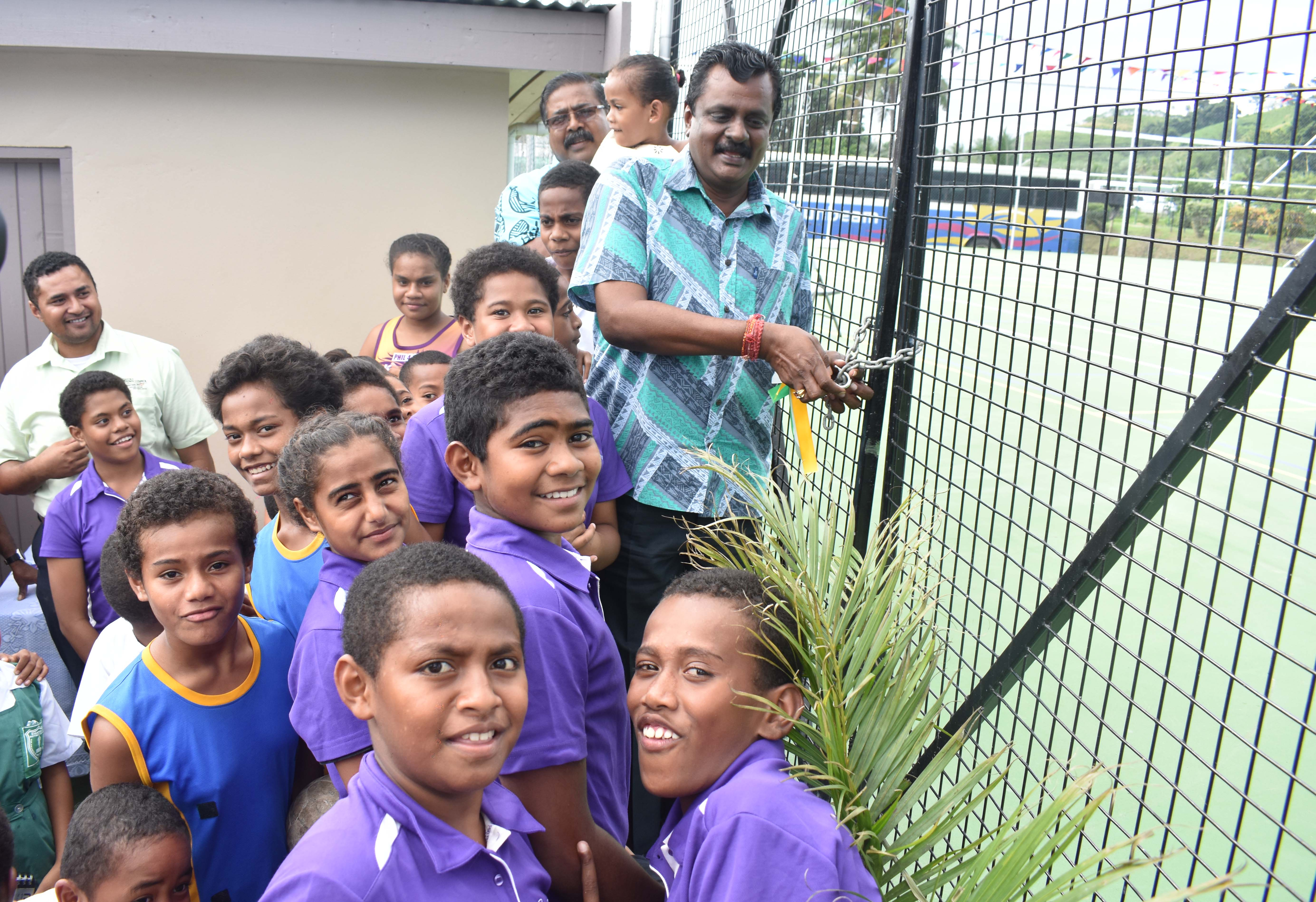 Minister for Local Government, Housing, Environment, Infrastructure and Transport Praveen Bala with students at the official opening of the Multi purpose court in Sigatoka yesterday. Photo: WAISEA NASOKIA
