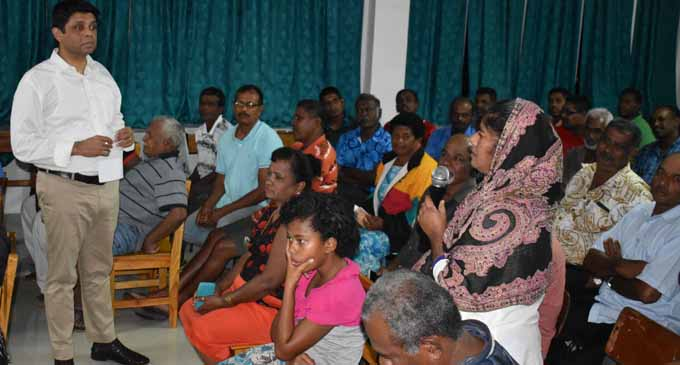 Minister for Economy and Attorney General Aiyaz Sayed-Khaiyum (left) listening to Afroza Bi, a sugarcane farmer's problem during a talanoa session at Waiqele College last night (May 31). Photo:SHRATIKA NAIDU