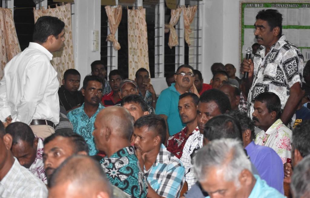 Minister for Economy and Attorney General Aiyaz Sayed-Khaiyum (left) listening to Damodar Mudaliar a sugarcane farmer's problem during a talanoa session at Waiqele College last night (May 31). Photo:SHRATIKA NAIDU