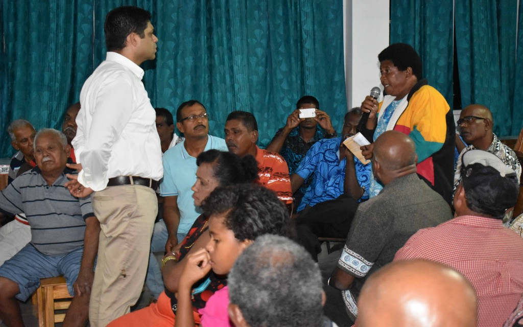 Minister for Economy and Attorney General Aiyaz Sayed-Khaiyum (left) listening to Akisi Vinaka, a sugarcane farmer's request for a quarters during a talanoa session at Waiqele College last night (May 31). Photo:SHRATIKA NAIDU