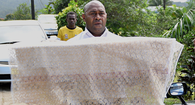 Sakaraia Liwaliwa(uncle) carries the casket of Agnes Fleur Louise Tuiloma on June 06, 2017. Photo: Vilimoni Vaganalau