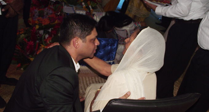Attorney-General and Minister for Economy Aiyaz Sayed-Khaiyum comforts Mrs Kanwal on July 19, 2017.