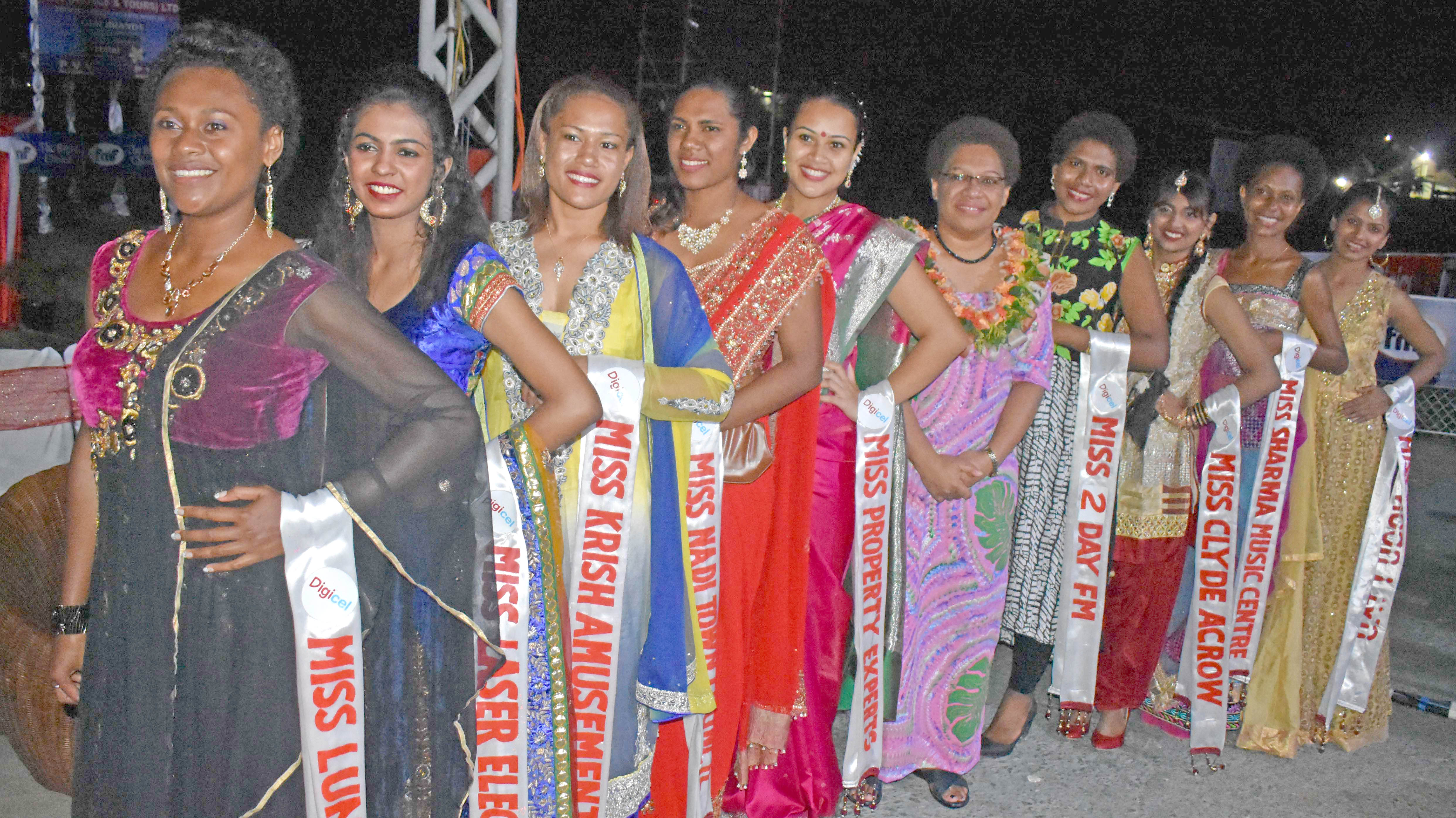Minister for Women, Children and Poverty Alleviation Mereseini Vuniwaqa with the contestants at the opening of the Digicel Nadi Bula Festival at the Prince Charles Park in Nadi yesterday. Photo: WAISEA NASOKIA