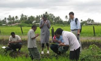 Villager Uses Manual Farming Equipment