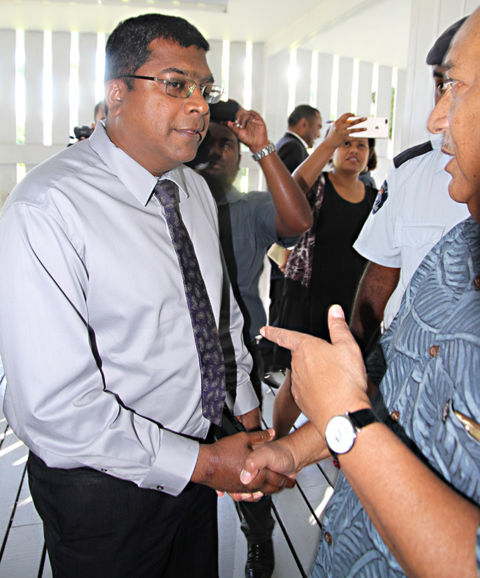 Minister for Education, Heritage and Arts Mahendra Reddy outside the Suva Magistrates Court with Defence Minister Ratu Inoke Kubuabola (right) on June 4, 2017. Photo: Ronald Kumar