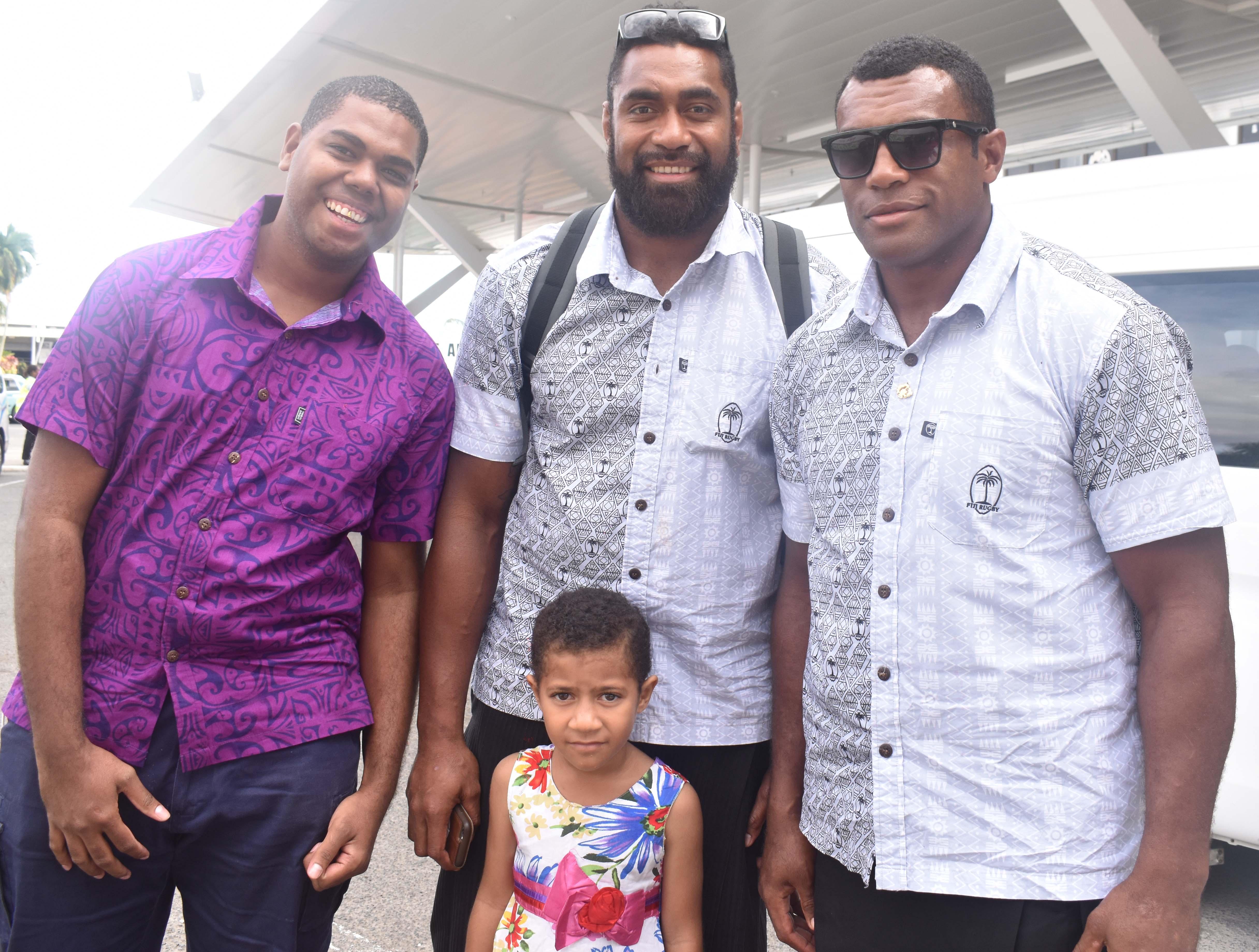 Vodafone Flying Fijians Tevita Cavubati (second from left) and Nemani Nagusa (right) with fans at the Nadi International Airport. Photo: Waisea Nasokia