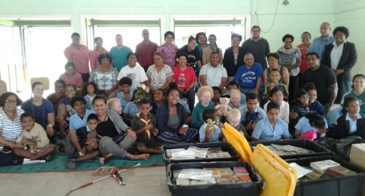 American Fijians' Donations Light Up Children's Faces