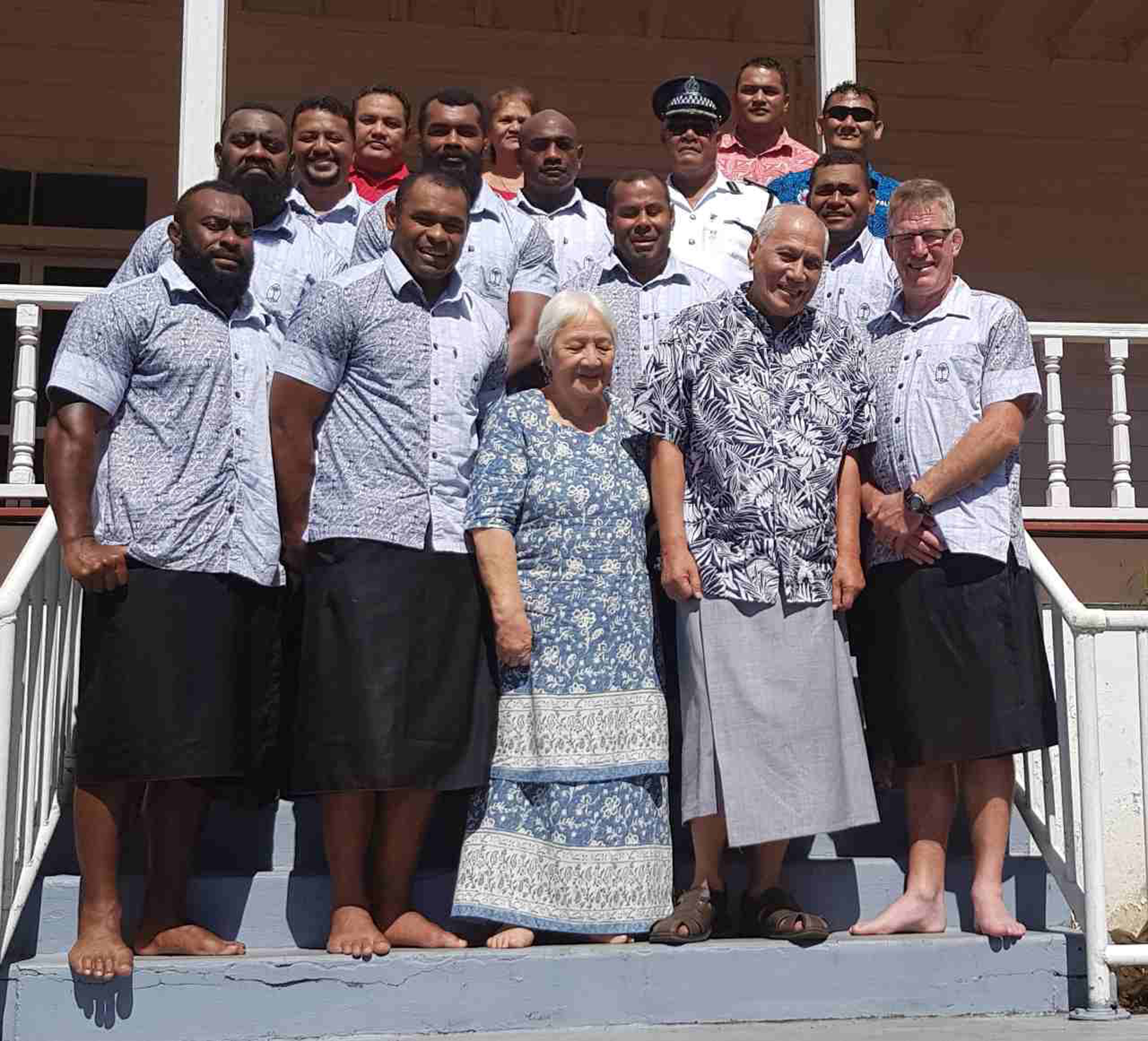 Samoa's Head of State Tui Atua Tupua Tamasese Efi (front, fourth from left) and wife Masiofo Filifilia(front, third from left) with some of the members of the Vodafone Flying Fijians team and coaching staff at their residence in Apia on July 12, 2017. Photo: FRU Media