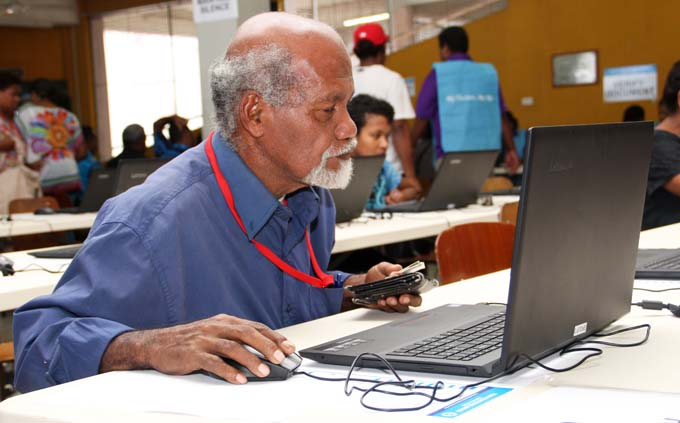 A man applies online during the Fijian Elections Office recruitment drive at the Kshatriya Hall in Suva on July 28, 2017. Photo: Fijian Elections Office