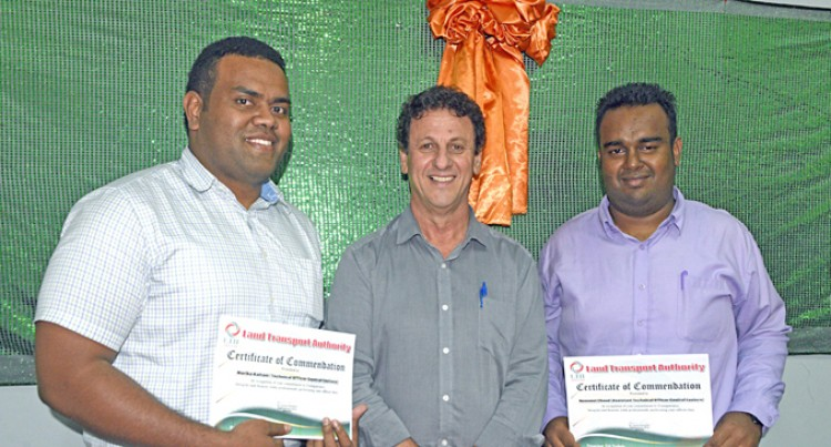 Transport duo get recognition for being honest officials