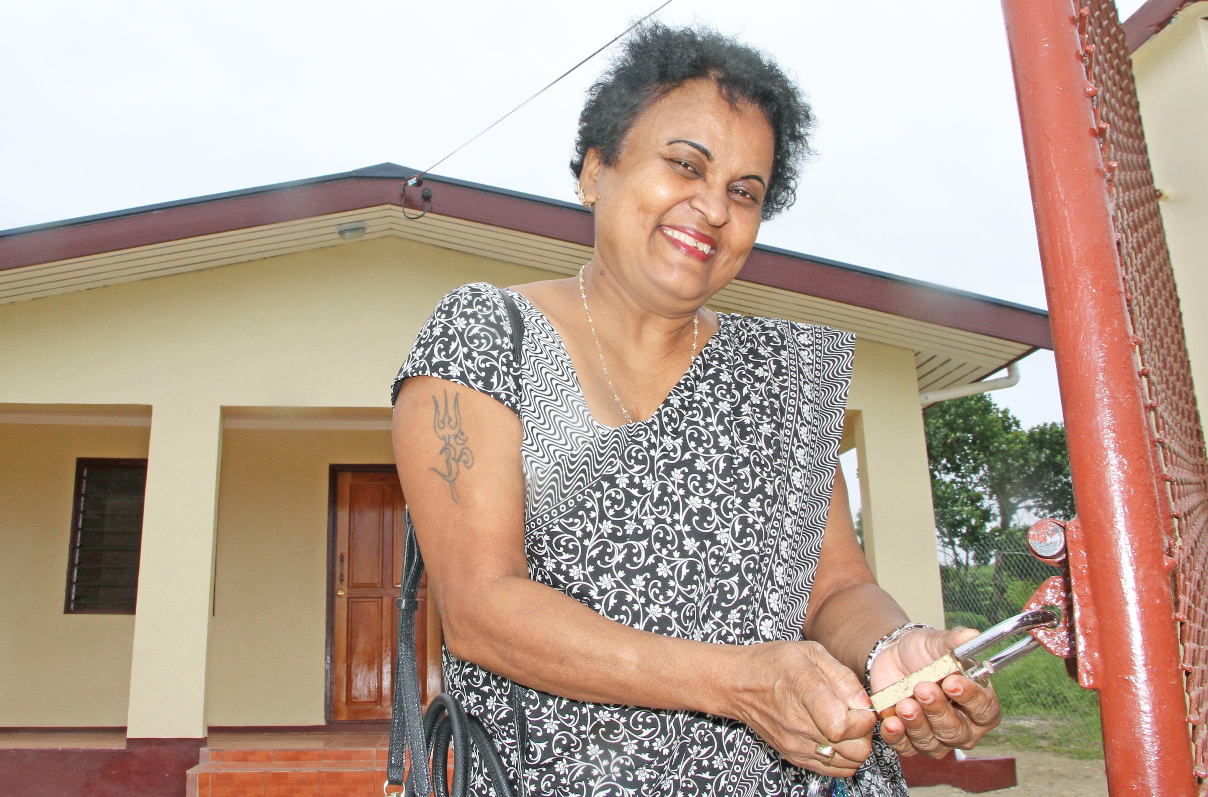 Muni Lata Kumar, 62, opens the gates to her new home at Wainibuku Subdivision, Nakasi on July 15, 2017. Photo: Ronald Kumar