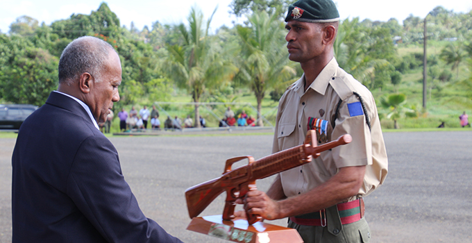 Corporal Etika Rokovesa receives his Best All Round award from Minister for Youth and Sports Laisenia Tuitubou. Photo: RFMF Media Cell