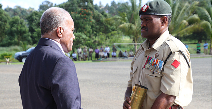 Lance Corporal, Akuila Rova  receives his  Best Leadership Award from Minister for Youth and Sports, Laisenia Tuitubou at the Pass Out Parade at the RFMF Force Training Group (FTG) in Nasinu yesterday. Photo: RFMF Media Cell