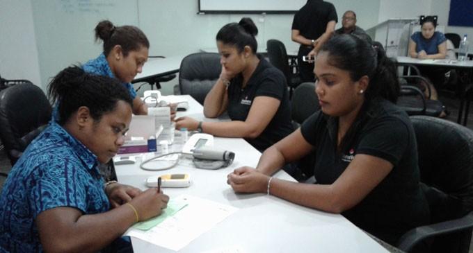 Staff undergo health screening at workplace