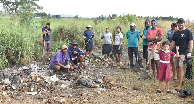 Vuda Marina general manager Adam Wade (far right) with his friends clear up the rubbish along the roadside in Waimalika in Sabeto yesterday. Photo: WAISEA NASOKIA