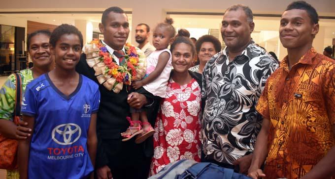Peniasi Vatuorooro of the Army Bears (RFMF), with family members at the Nadi International Airport on July 17, 2017. Photo: Waisea Nasokia