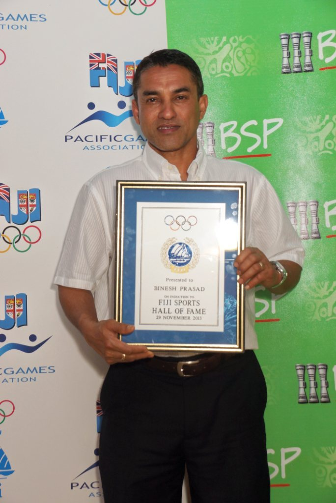Binesh Prasad with his recognition from FASANOC