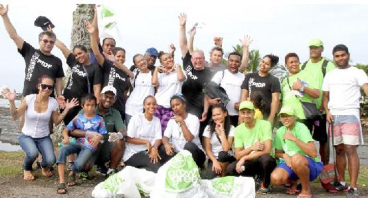 Forum Staff Pick Rubbish At Suva Point