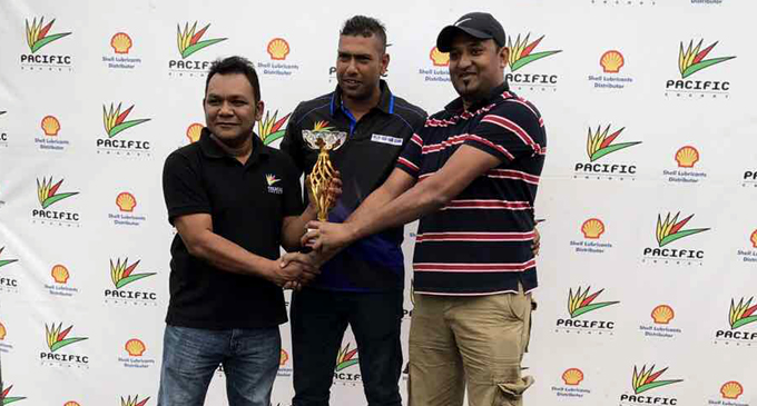 Pacific Energy marketing manager Rajnesh Prasad (left) and Fiji Car Club president Raizal Haniff (middle) present the Pacific Energy Quarter Mile Drag Race trophy to Vicky Nath who clocked the best time and also won the 11 seconds category. Photo: Rachna Lal