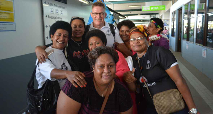 Vodafone Flying Fijians head coach John McKee with Fijian supporters at Fua'amotu International Airport in Nuku'alofa, Tonga on July 4, 2017. Photo: Iliesa Tora, Nuku'alofa Times