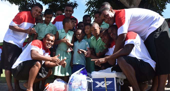 Warwick Navosa provincial rugby team with students of the Sigatoka School for Special Education on July 13, 2017. Photo: Waisea Nasokia