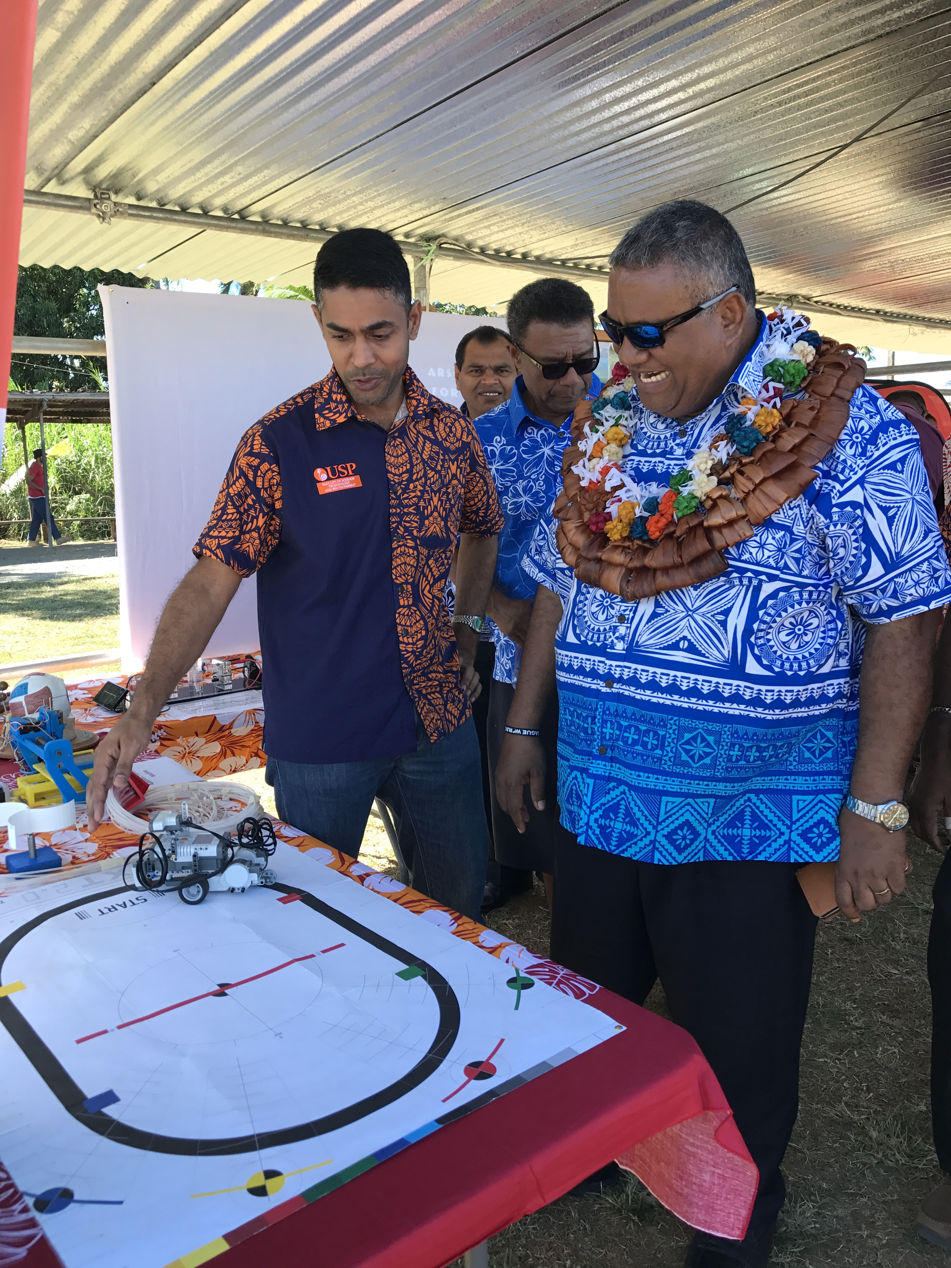 University of the South Pacific School of Engineering and Physics lecturer Sumesh Narayan (left), showing the chief guest Permanent Secretary for Education, Heritage and Arts IowaneTiko the line following robot during the University of the South Pacific Open Day at Subrail Park in Labasa on July 28, 2017. Photo: Shratika Singh