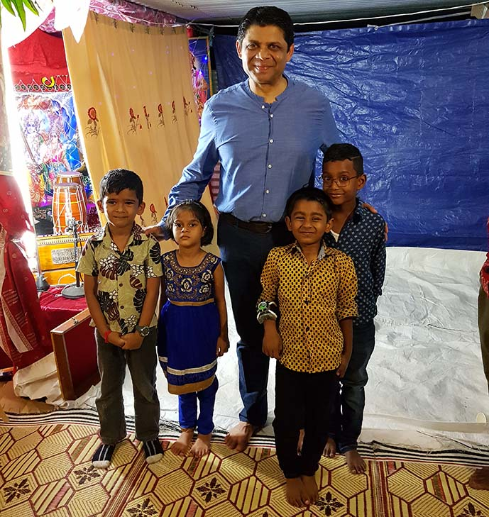 The Attorney-General, Aiyaz Sayed-Khaiyum, with young Hindu devotees attending a Shri Krishna Janmashtami gathering. Photo: Office of the Attorney-General