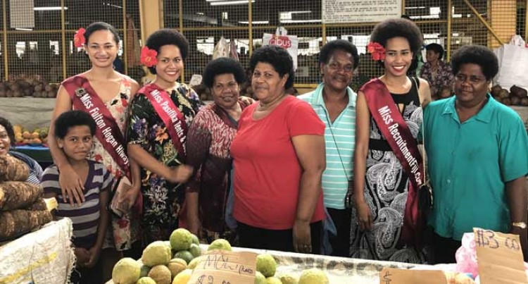 Queens Engage With Suva Market Community
