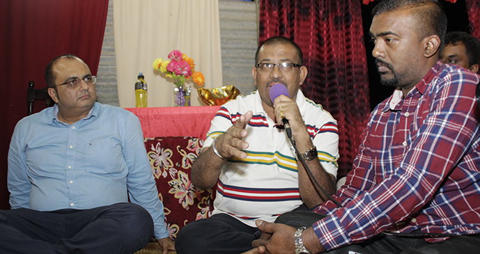 Divisional Police Commander East Senior Superintendent of Police Manoj Singh (left), explains the reason why Koronivia Police post was closed. Next to him is president of Vishva Hindu Prishad Rewa branch, former radio personality Roneel Narayan. Photo: Office of the Attorney-General