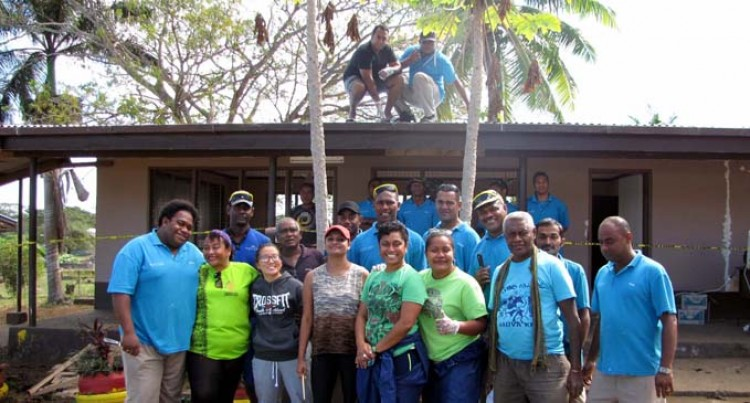 Hotel Staff Volunteer To Renovate School