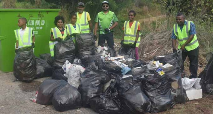 Company Initiates Cleanup  Campaign Along Highway