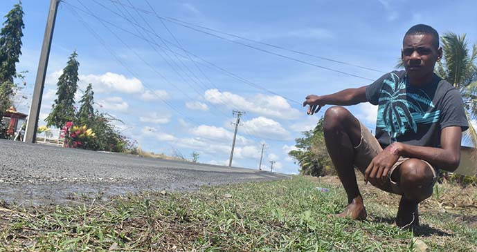 Eseroma Nasiga points to where his father was found lying on the side of Sonaisali Road, Nadi, on August 13, 2017. Photo: Waisea Nasokia