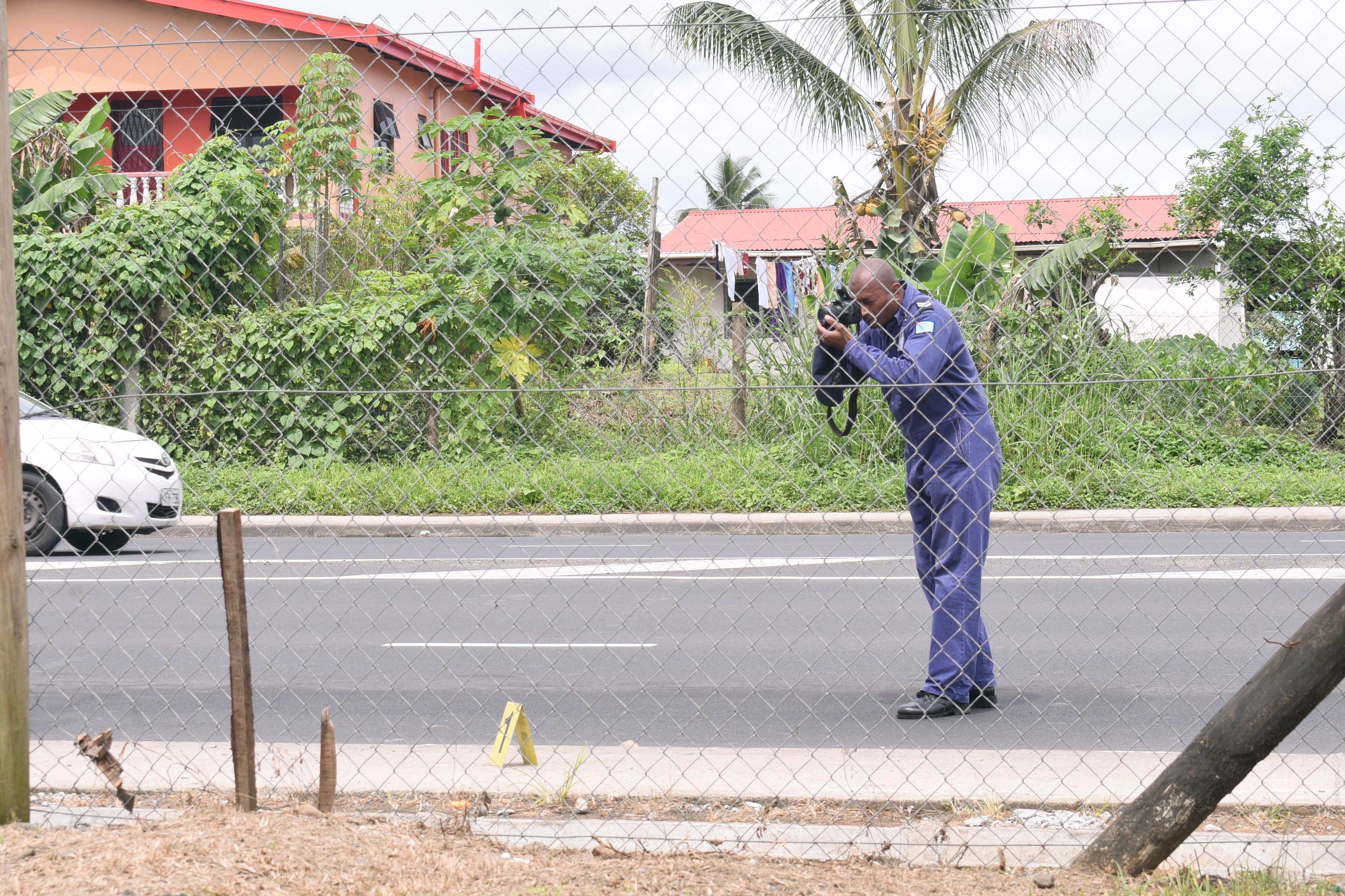 Forensic police team member photographign the scene of the accident outside the Nasole Masjid that claimed the life of a Bangaldeshi Muslim clergy on Saturday September 9th, 2017. Photo:Jone Luvenitoga
