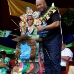 PM Voreqe Bainimarama has his  thumps up for teary oratory winner Timoci Naulusala of Naivicula Primary School. Photo:Jone Luvenitoga